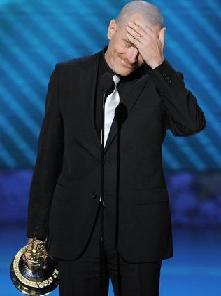 Cranston accepts the award for outstanding lead actor in a drama series at the 2008 Emmy Awards. Picture: AP