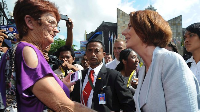 Australian Prime Minister Julia Gillard, right, meets a tourist from Australia during her visit to the Bali Memorial Monument in Kuta, Bali. Picture: Sony Tumbelaka