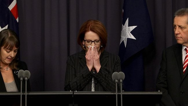 An emotional PM Julia Gillard with Minister for Higher Education and the government leader in the Senate Chris Evans and Attorney-General Nicola Roxon at a press conference in Parliament House, Canberra. Picture: Kym Smith