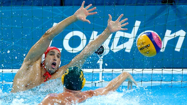 Gavin Woods (right) of Australia shoots and scores a gaol past the outstretched hands of goalkeeper Merrill Moses of the United States during the men's water polo seventh place match.