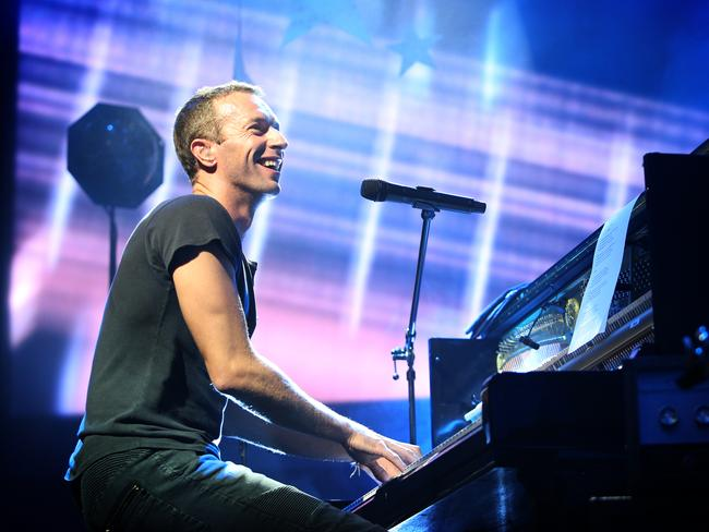 All smiles ... Frontman Chris Martin fed off the electric energy of diehard fans who packed the Enmore. Picture: Richard Dobson