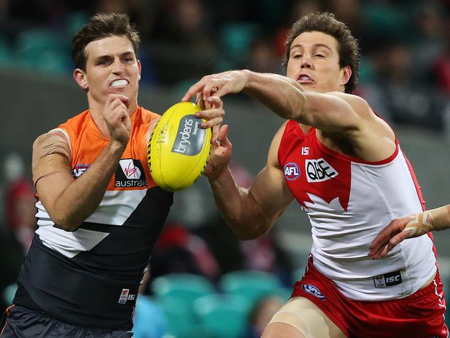 Phil Davis and Kurt Tippett contest a mark during Round 15. Pic: Phil Hillyard