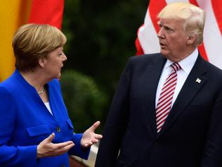 German Chancellor Angela Merkel talks with US President Donald Trump as they attend the Summit of the Heads of State and of Government of the G7, the group of most industrialized economies, plus the European Union, on May 26, 2017 at the ancient Greek Theater in Taormina, Sicily. The leaders of Britain, Canada, France, Germany, Japan, the US and Italy will be joined by representatives of the European Union and the International Monetary Fund (IMF) as well as teams from Ethiopia, Kenya, Niger, Nigeria and Tunisia during the summit from May 26 to 27, 2017. / AFP PHOTO / Miguel MEDINA