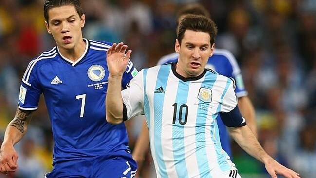 Muhamed Besic keeps a close eye on Lionel Messi during the World Cup.