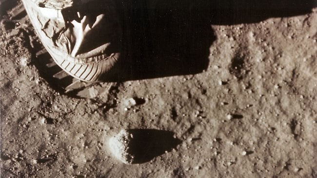 "In this photo from NASA, Apollo 11 commander Neil Armstrong's right foot leaves a footprint in the lunar soil July 20, 1969 as he and Edwin ""Buzz"" Aldrin become the first men to set foot on the surface of the moon. Photo: AFP"