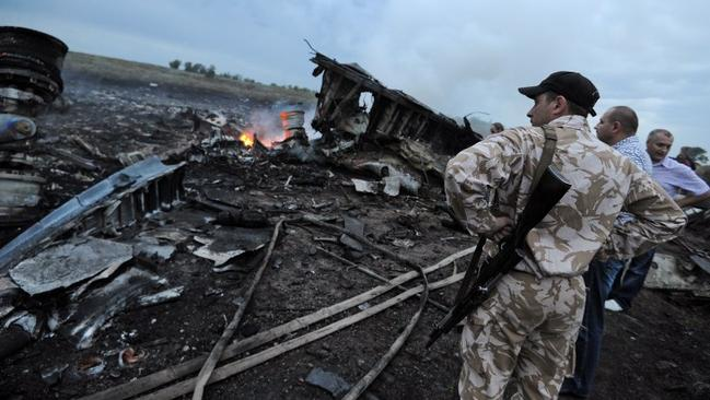 Armed men at the wreckage of MH17