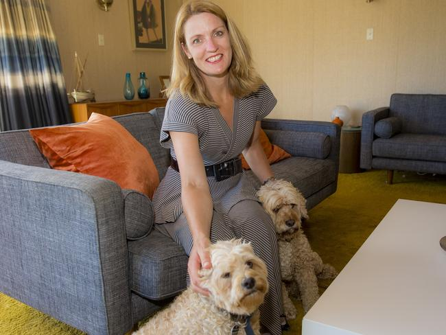 Katrina pictured with her two dogs. She's now resigned to the fact that she'll never have children. Picture: Richard Tuffin