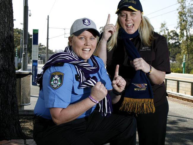 Lining up: Dockers supporter Tiffany Harken, left, and her Eagles supporting twin sister Brie are hoping for a western derby Grand Final in Melbourne on October 3. Picture: Marie Nirme