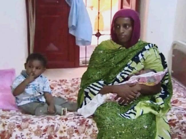 Detained ... Meriam Ibrahim with Martin, her 18-month-old son, and her newborn baby girl that she gave birth to in jail.