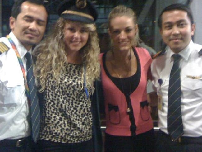 MH370 co-pilot Fariq Hamid (far right) was known for inviting attractive passengers into the cockpit for photo opportunities and a smoke.