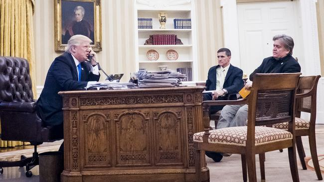 President Donald Trump on the phone to Prime Minister Malcolm Turnbull while National Security adviser Michael Flynn and Senior Counsellor to the President Steve Bannon watch on. Picture: Pete Marovich/Consolidated News Photos