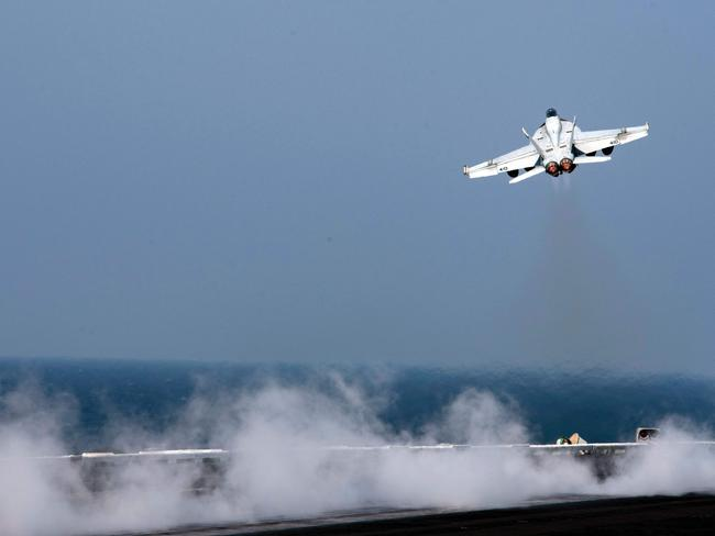 An F/A-18E Super Hornet shot down a Syrian regime plane on Sunday after it dropped bombs on US-backed forces fighting the Islamic State group in northern Syria. Picture: AFP/Navy Media Content Operations/Petty Officer 3rd class Nathan T Beard