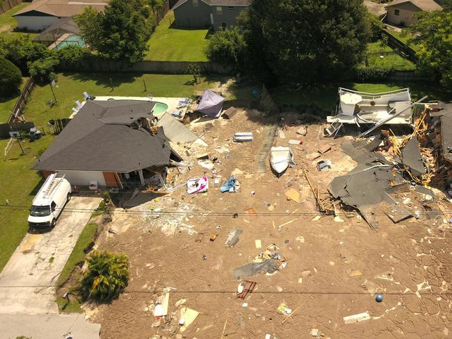 The sinkhole left nothing as it grew in size and took two homes in its path. Picture: Luis Santana/Tampa Bay Times via AP