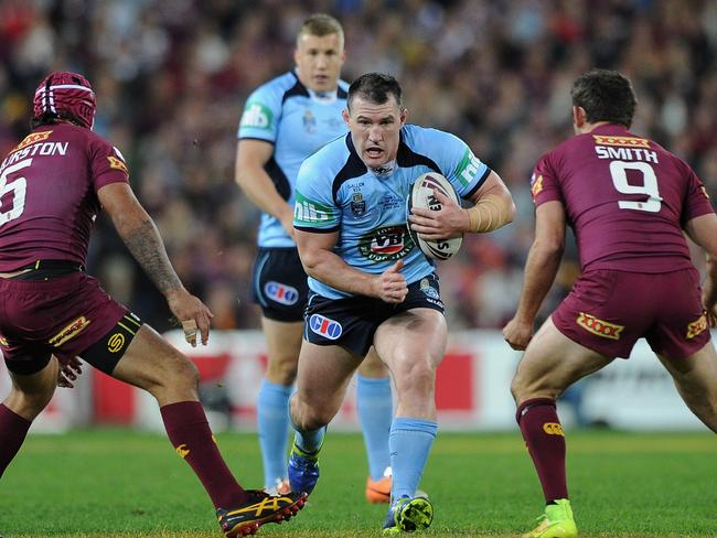 Paul Gallen of the Blues takes on the Queensland defence during State of Origin III.