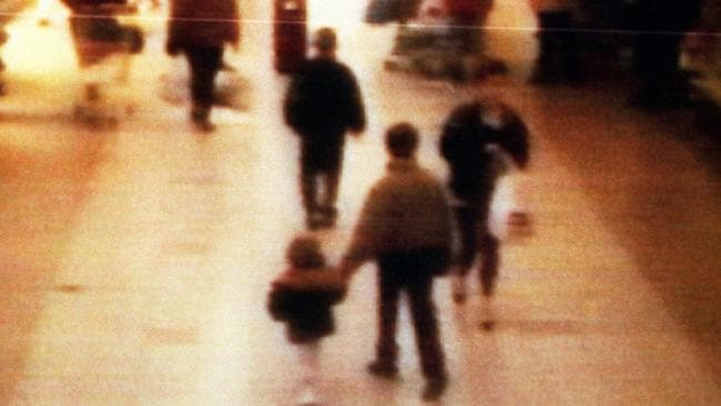 A surveillance camera shows the abduction of two-year-old James Bulger, who holds the hand of Jon Venables, one of two ten-year-old boys later convicted of his torture and murder. Picture: BWP Media via Getty Images