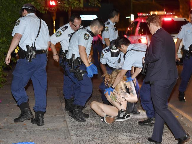 Police arrest the alleged assailant a short distance from the 7-Eleven and allegedly seize an axe. Picture: Gordon McComiskie