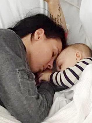 Teagan Moore and her son in hospital after the attack.