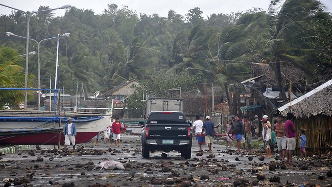 Debris litter the road by the coastal village in Legazpi city which was hit by Typhoon Haiyan. Picture: AP Photo/Nelson Salting