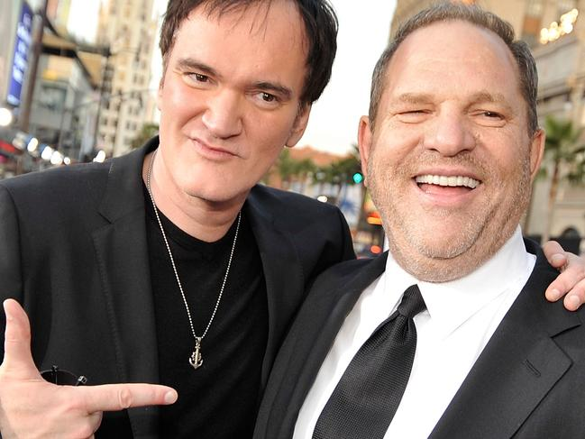 """(FILES) This file photo taken on August 10, 2009 shows director Quentin Tarantino (L) and producer Harvey Weinstein arriving at the premiere of Weinstein Co.'s """"Inglorious Basterds"""" held at Grauman's Chinese Theatre in Hollywood, California.    Quentin Tarantino has admitted knowing for decades about Harvey Weinstein's alleged sexual misconduct, confessing in an interview published on October 19, 2017 to feeling ashamed that he did not stop working with the mogul. / AFP PHOTO / GETTY IMAGES NORTH AMERICA / KEVIN WINTER"""