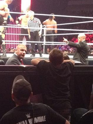Triple H and the boy exchange words as the match continues. Picture: @chrisolds2009