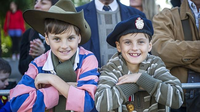 Twins Thomas and Charlie Windsor wearing service medals from five different relations. Picture: Eugene Hyland