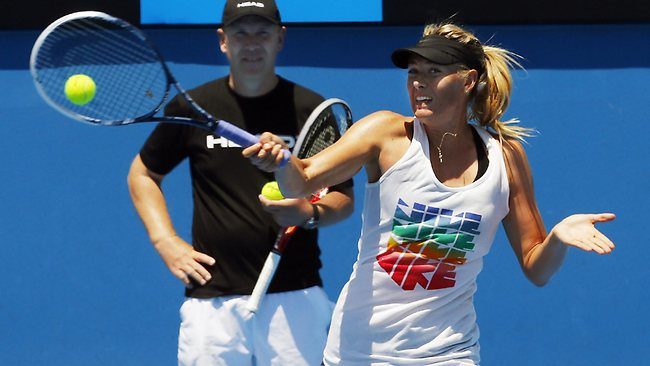 Maria Sharapova practising at Melbourne Park under the watchful eye of former coach Thomas Hogsted. Picture: Michael Klein