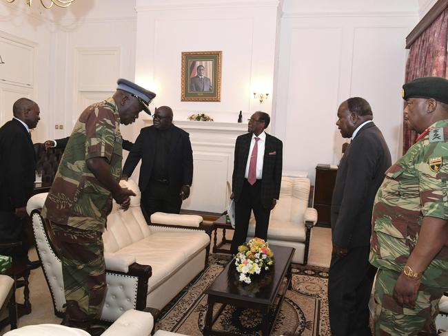 Robert Mugabe, centre, meets with Defence Forces Generals at State House, in Harare, where he was expected to resign. Picture: Zimbabwe Herald via AP