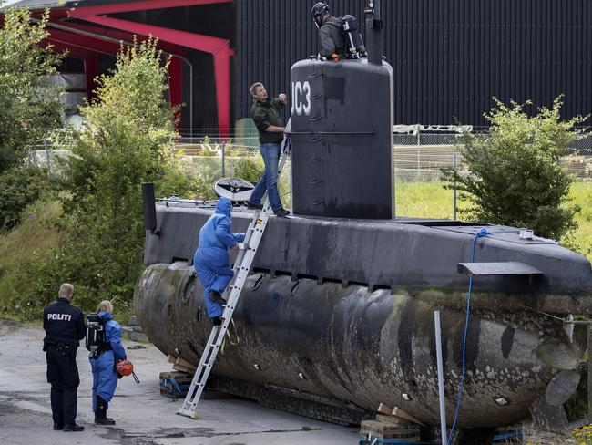 Police board Peter Madsen's submarine during the search for Kim Wall. Picture: Jacob Ehrbahn/Ritzau Foto
