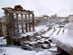 A picture taken in Rome on February 26, 201 shows a view of the Ancient Forum and a snowman during a snowfall. Picture: AFP PHOTO / Vincenzo PINTO
