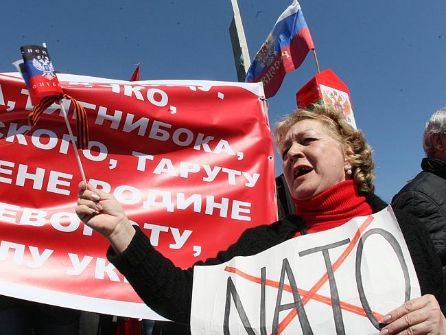 A pro-Russian protester holds an anti-NATO placard during a rally in Donetsk. Picture: AFP