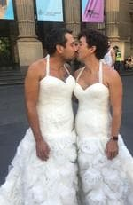 Melbourne: Dressed in wedding dresses, partners Luke Meehan, 33, and George Papagiammopoulous, 35 outside the State Library in Melbourne. SSM. Picture: Supplied
