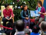 <p>Malia and Sasha Obama daughters of US President Barack Obama, read the book 'Snowmen at Night' by Caralyn Buehner, with their mother, First Lady Michelle Obama during a visit to the Children's National Medical Center in Washington, DC, on December 22, 2009. AFP</p>