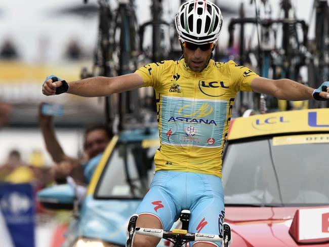 In front ... Italy's Vincenzo Nibali wearing the overall leader's yellow jersey celebrates as he crosses the finish line at the end of the 145.5km eighteenth stage of the Tour de France.