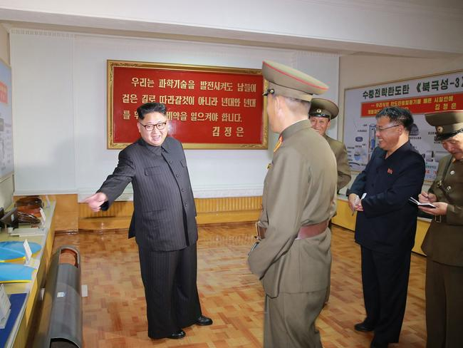 Kim Jong Un, left, visits the Chemical Material Institute of Academy of Defense Science at an undisclosed location in North Korea. Picture: KCNA/AFP