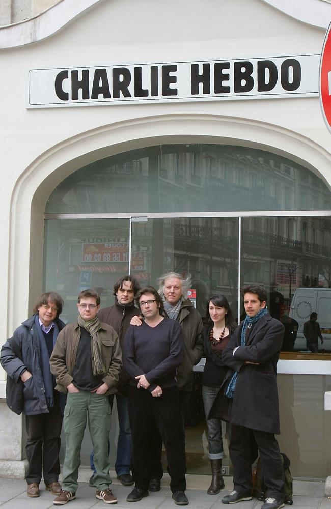 Staff ... members of the French satirical newspaper Charlie Hebdo pictured in 2006, including cartoonists Cabu (L), Charb (2nd L), Tignous (4th L) and Honore (5th L) posing in front of the then headquarters of the weekly in Paris. Picture: Joel Saget