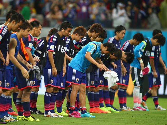 The Japan players acknowledge the fans after being defeated by the Ivory Coast 2-1 during the 2014 FIFA World Cup Group C match against Ivory Coast.