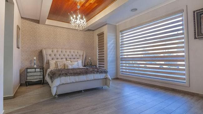 A chandelier in the main bedroom is a lavish touch.