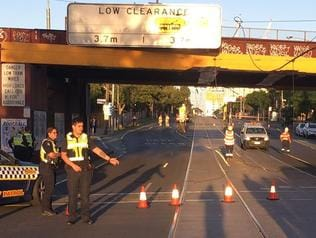EARLY morning commuters are facing delays after a truck brought down powerlines on Racecourse Rd near Newmarket train station this morning.