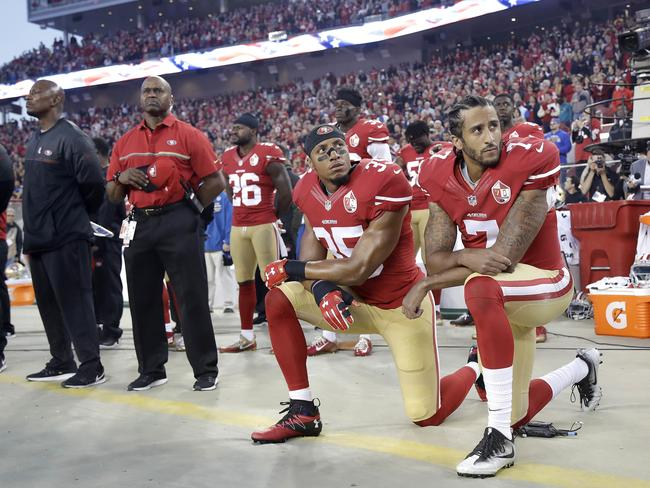 Colin Kaepernick (right) and Eric reid take a knee before a San Francisco 49ers game. Picture: AP/Marcio Jose Sanchez