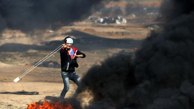 A Palestinian youth hurls a stone during clashes with Israeli forces on May 15, 2018 near the border fence with Israel east of Jabalia in the central Gaza Strip. Picture: AFP