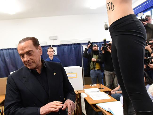 Berlusconi was apparently unphased by the FEMEN activist. Picture:AFP/Miguel Medina