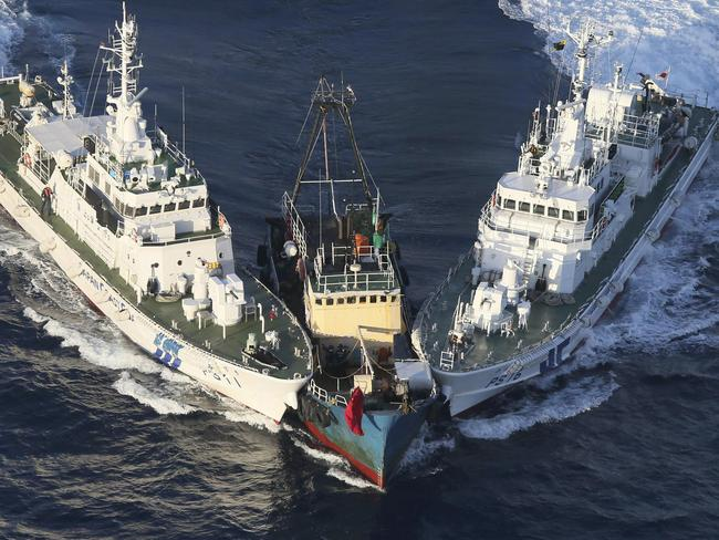 A fishing boat, centre, is surrounded by Japan Cost Guard's patrol boats after activists descended from the boat on Uotsuri Island, one of the islands of Senkaku in Japanese and Diaoyu in Chinese, in East China Sea in 2012. Picture: AP