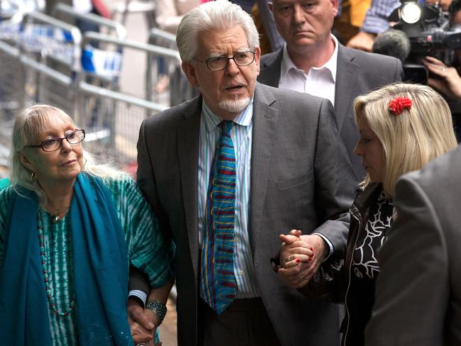 During the trial ... Rolf Harris leaves court holding the hands of his wife Alwen Hughes (left) and daughter Bindi Harris (right). Picture: Matthew Lloyd