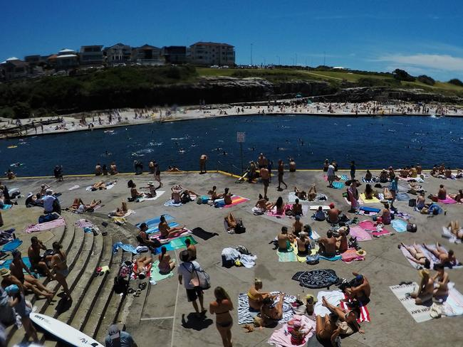 Hundreds of people tried to keep cool at Clovelly yesterday. Picture: Jenny Evans