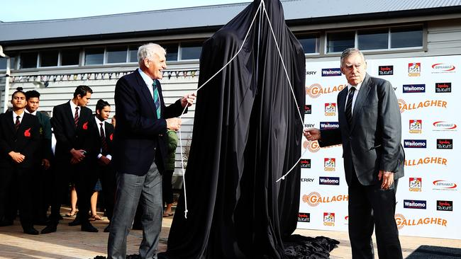 Former All Blacks players Stan Meads and Sir Colin Meads (R) unveil a new statue in Te Kuiti, New Zealand.