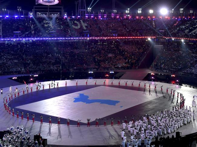 Athletes from South Korea and North Korea arrive during the opening ceremony of the 2018 Winter Olympics in Pyeongchang. Picture: Christof Stache/Pool Photo via AP.