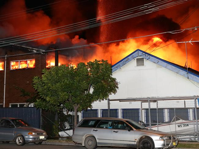 Fire has destroyed a storage complex on Burrows Road, Alexandria. Flames were seen rising 30 metres into the air with explosions heard coming from within. Photo: Bill Hearne