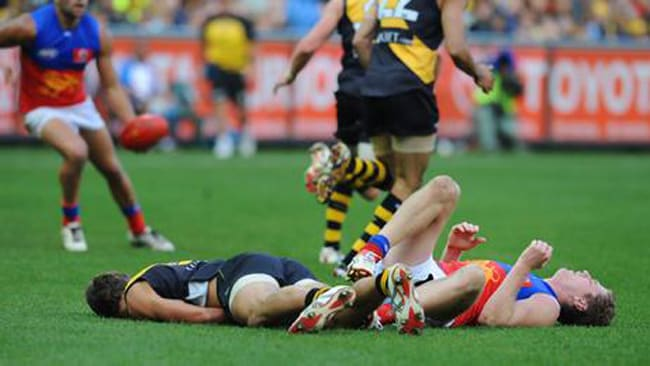 Alex Rance (Tigers) and Troy Selwood (Lions) knock each other out in an AFL collision. Picture: Getty