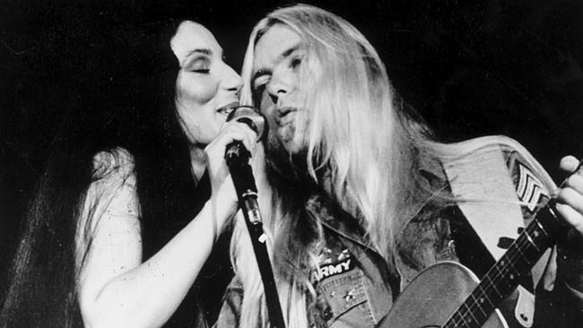 Singer Greg Allman on stage with wife Cher in 1977. Shooting for Allman's biopic has been marred by tragedy.