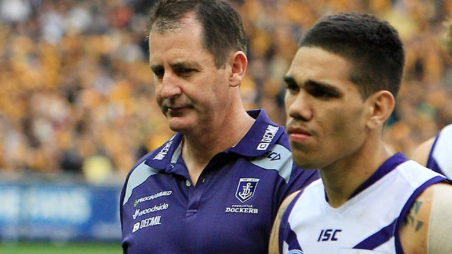 Fremantle coach Ross Lyon (left) walks off the MCG after losing his fourth Grand Final as coach. Picture: Chris Scott